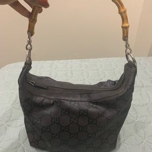 Gucci bamboo handle shoulder bag.